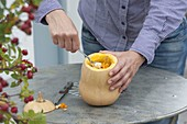 Use butternut squash as a vase and plant pot