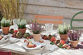 Garland made of clay pots and fruit stands as a table decoration