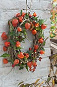 Illuminated clematis wreath with fairy lights in physalis