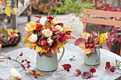 Autumn bouquet of Rose, physalis, malus
