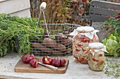 Wire basket with freshly harvested carrots, carrots (Daucus carota)