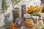 Jars with dried flowers and leaves for tea blends