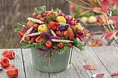 Autumn bouquet with fruits, berries and ears of wheat