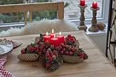 Pine cone star with fruits and berries as Advent wreath
