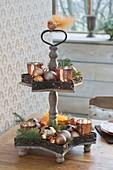 Metal etagere with copper-colored lanterns, glassbirds