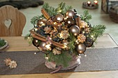 Christmas bouquet with copper-brown tree balls, branches of Abies nobilis