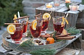 Glasses with punch, slices of orange, cinnamon sticks, star anise
