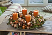 Mixed Advent wreath with orange candles, tree balls