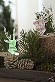 Christmas forest decoration with colored LED light deer