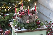 Basket filled with cones and malus as Advent wreath