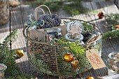 Wire basket with cones, abies branches, jars with seeds