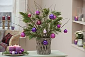 Bouquet of Pinus twigs decorated with berry colors