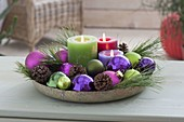 Bowl with candles, balls, cones, branches of pinus (pine)