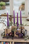 Unusual Advent decoration, candle holder on wooden blocks