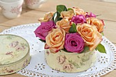 Small flower cake from pink (rose) flowers in cookie jar