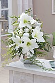 Silver and white Christmas bouquet of Hippeastrum, Asparagus