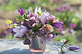 Pink purple bouquet of Magnolia and Helleborus branches