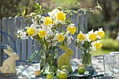 Yellow-white Easter bouquets of Narcissus (narcissus) and branches