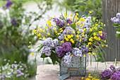 Fragrant bouquet from Syringa, Ranunculus acris