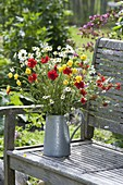 Bouquet made of perennials and meadow flowers in zinc can