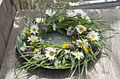 Wreath made of meadow flower , grasses, leucanthemum (marguerite)