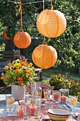 Garden party with orange lanterns as decoration