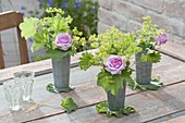 High zinc cups as vases with Alchemilla mollis and roses