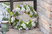 Fragrant wreath of syringa, viburnum and alchemilla