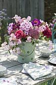 Fragrant table decoration of Phlox paniculata, Lathyrus