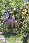 Woman enjoying the summer in the garden