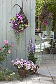 Terrace with homemade flower baskets and willow pots