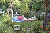Hammock for relaxing in the small garden between trees