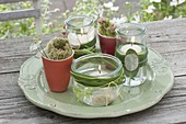 Preserving jars with floating candles as lanterns