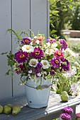 Rural late summer bouquet in enameled bucket