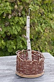 Build hanging basket out of wicker and floor wood