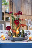Autumn table decoration with pieces of giant knotweed