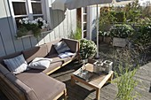 Summer deck with lounge corner and parasol