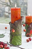 Natural candle deco on the window