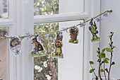 Easter window decoration, string with Easter wafers