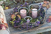 Preserving jars as lanterns in autumn wreath