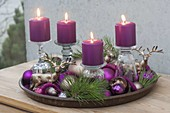 Unusual Advent wreath with candles on inverted glasses