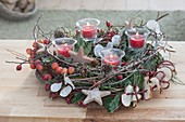 Natural Advent wreath made of malus (ornamental apple) branches