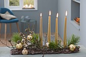 Advent arrangement on bark as an unusual Advent wreath