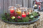 Advent wreath made of preserving jars as lanterns