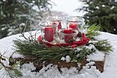 Advent wreath of misused jars as lanterns