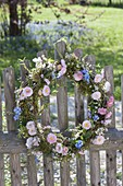 Wicker wreath with spring flowers