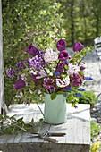 Pink-purple tulips 'Purple Prince' and Viburnum carlcephalum bouquet