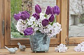 Small bouquet with Tulipa 'Purple Prince' and Prunus branches