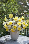 White-yellow bouquet of narcissus (narcissus) and twigs
