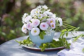 Mini bouquet in a cup as a vase, Bellis (daisies), wild garlic